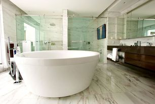 Contemporary Master Bathroom with linen and towel storage cabinet, High ceiling, Casement, Bathtub, Soapstone counters, Flush