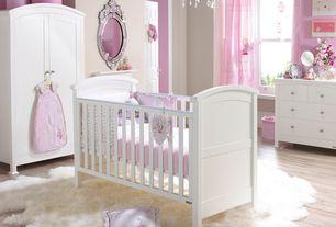 Traditional Kids Bedroom with Hardwood floors, Crib, Dresser, Chandelier, Armoire, Contemporart venetian mirror, Wooden crib