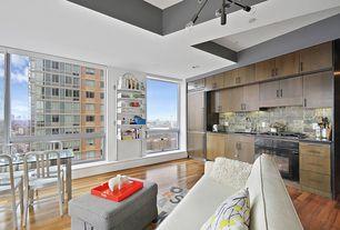 Contemporary Great Room with Built-in bookshelf, Hardwood floors, Chandelier, High ceiling