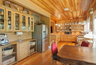 Rustic Kitchen with European Cabinets, Multiple Refrigerators, Casement, electric cooktop, Limestone counters, Custom hood