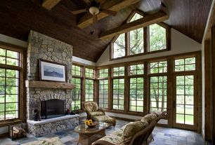 Rustic Living Room with Black Bear Manufactured Fieldstone-Midnight, Exposed beam, Casement, Exposed wood ceiling, Fireplace