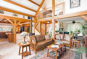 Craftsman Great Room with Exposed beam, flush light, High ceiling, Loft, Built-in bookshelf, limestone tile floors, Columns