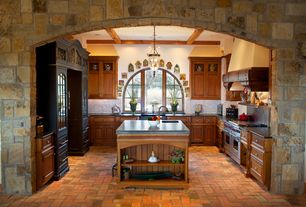 Country Kitchen with Standard height, Exposed beam, Undermount sink, Ceramic Tile, can lights, U-shaped, double oven range