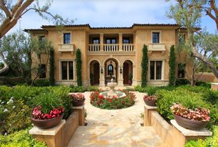 Mediterranean Exterior of Home with Fence, Fountain, exterior stone floors