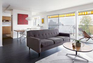 Contemporary Great Room with Built-in bookshelf, Laminate floors, Balcony, flush light, Pendant light