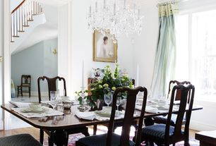 Traditional Dining Room with Chandelier, Hardwood floors, Crown molding, High ceiling