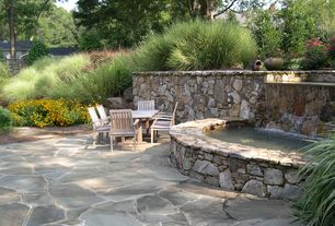 Rustic Patio with exterior stone floors, Pond, Raised beds, Fountain, Fence