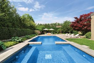 Contemporary Swimming Pool with Fence, Pool with hot tub, exterior tile floors, Raised beds