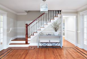 Traditional Entryway with Pendant light, Chair rail, Standard height, Hardwood floors, Crown molding, French doors