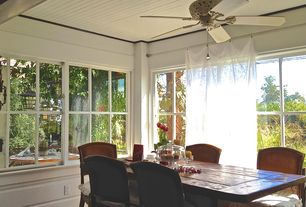 Cottage Dining Room with Standard height, Hardwood floors, Ceiling fan, Casement