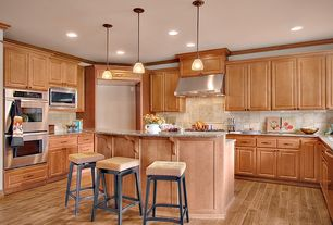 Traditional Kitchen with Undermount sink, Crown molding, Stone Tile, U-shaped, Breakfast bar, Pendant light, Kitchen island