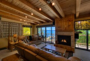 Rustic Living Room with Carpet, flush light, stone fireplace, Exposed beam