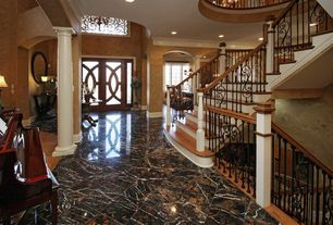 Traditional Entryway with simple marble tile floors, interior wallpaper, Columns, High ceiling, French doors