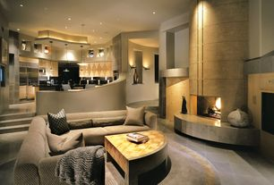 Modern Great Room with Fireplace, Pendant light, Concrete tile , Built-in bookshelf, High ceiling, Wall sconce, can lights