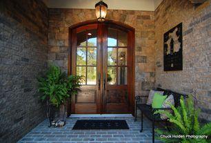 Traditional Front Door with Glass panel door, exterior brick floors