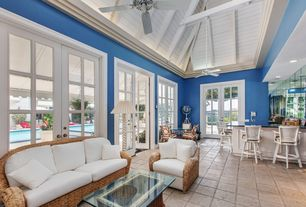 Cottage Great Room with French doors, Exposed beam, Ceiling fan, limestone tile floors, TANGIERS SEAGRASS SOFA, Crown molding