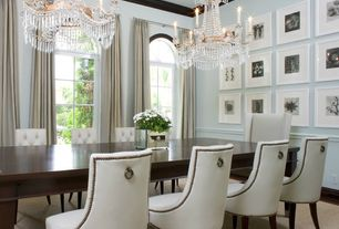 Traditional Dining Room with Chair rail, Schonbek crystal chandelier in heirloom bronze finish, Crown molding, Chandelier