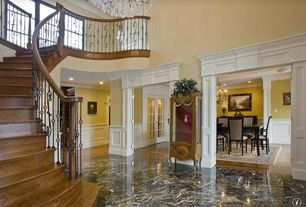 Traditional Entryway with complex marble tile floors, Chandelier, High ceiling, stone tile floors