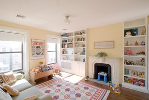 Traditional Playroom with Schoolhouse flush mount ceiling light, Hardwood floors, Cement fireplace, Built-in bookshelf