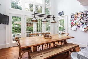 Traditional Dining Room with High ceiling, Pendant light, Hardwood floors, French doors