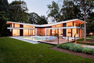 Modern Exterior of Home with Outdoor reclining chairs, Outdoor pool