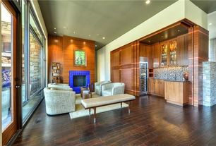 Contemporary Living Room with picture window, can lights, Fireplace, Glass panel door, insert fireplace, Hardwood floors