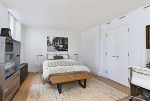 Modern Guest Bedroom with Hardwood floors