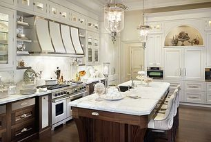 Traditional Kitchen with Crown molding, full backsplash, Flat panel cabinets, Undermount sink, Breakfast bar, Glass panel