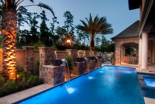 Mediterranean Swimming Pool with Pathway, Fountain, exterior stone floors, Lap pool, Fence, Outdoor kitchen