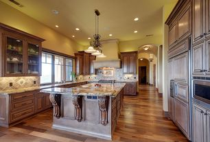 Mediterranean Kitchen with High ceiling, full backsplash, can lights, U-shaped, Pendant light, Stone Tile, built-in microwave