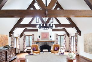 Traditional Living Room with Casement, Chandelier, metal fireplace, Exposed beam, Hardwood floors, stone fireplace, Fireplace