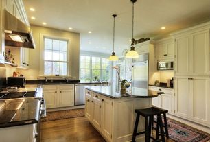 Traditional Kitchen with Pendant light, Kitchen island, Simple granite counters, Flat panel cabinets, Standard height, Flush