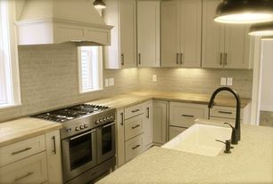 Traditional Kitchen with Corian fossil solid surface countertop, Heirloom wood countertops natural bamboo plank