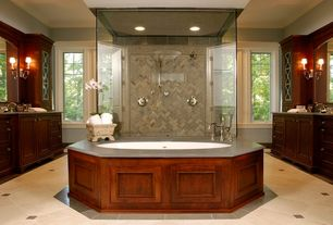 Traditional Master Bathroom with Bathtub, Master bathroom, drop in bathtub, specialty door, stone tile floors, Simple Granite