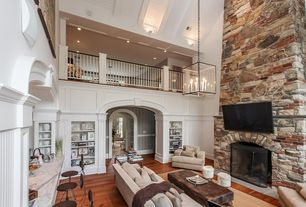 Traditional Living Room with High ceiling, Chandelier, Wall sconce, Hardwood floors, stone fireplace, Balcony, Wainscotting