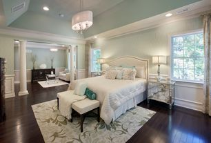 Traditional Master Bedroom with Crown molding, Columns, Wainscotting, Chandelier, Hardwood floors, High ceiling