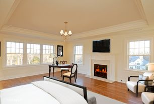 Traditional Master Bedroom with Crown molding, Hardwood floors, Chandelier, Cement fireplace