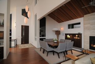 Contemporary Dining Room with Pendant light, Ceiling fan, High ceiling, Exposed beam, flush light, Wall sconce