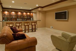 Modern Man Cave with New wood top grain leather sofa scroll arms 3-seater antique look, limestone tile floors, can lights
