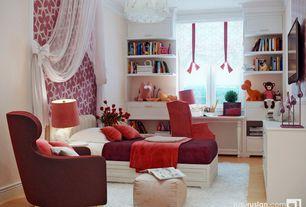 Traditional Kids Bedroom with Chandelier, Crown molding, interior wallpaper, Hardwood floors, Built-in bookshelf