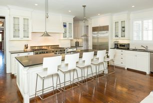 Traditional Kitchen with can lights, L-shaped, Subway Tile, double oven range, Flat panel cabinets, full backsplash, Casement