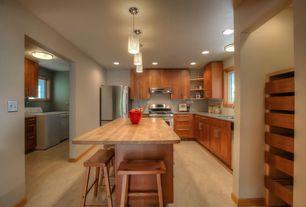 "Contemporary Kitchen with Butcher Block Countertop, 4"" Wooden Bar Stool, Built-in bookshelf, Pendant light, limestone floors"