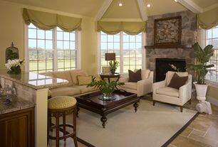 Traditional Living Room with Concrete tile , stone fireplace, Exposed beam, High ceiling