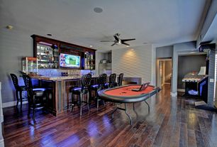 Traditional Game Room with Paragon theater pop 8 oz. popcorn machine, Emerson cf955 midway eco 54 in. indoor ceiling fan