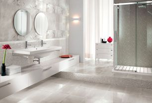 Contemporary Master Bathroom with complex marble tile floors, Wall mounted sink, Corian counters, Wall sconce, Rain shower