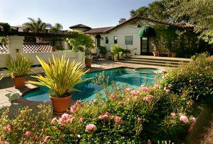 Mediterranean Swimming Pool with Fence, picture window, Stained glass window, exterior concrete tile floors, Raised beds
