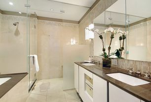 Contemporary Master Bathroom with Stone Tile, Flush, Double sink, Limestone Tile, limestone tile floors, Wall sconce