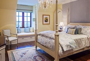 Traditional Master Bedroom with Hardwood floors, Casement, Chandelier, specialty door, can lights, Standard height