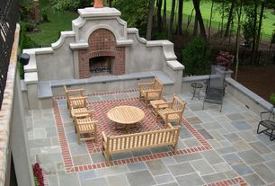 Traditional Patio with exterior stone floors, Fence