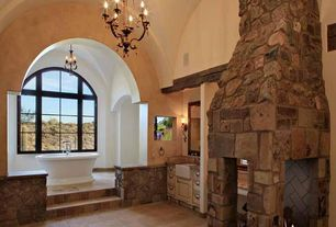 Traditional Master Bathroom with Master bathroom, Arched window, Flush, Freestanding, Farmhouse sink, Raised panel, Limestone